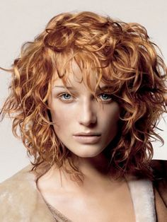 Closest thing I've seen to the hair I want but longer than this and maybe no bangs.  SO over the triangle hair (roseanna roseanna dana), this is more diamond shaped. SO hard to find a good curly STYLE!