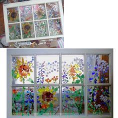 Mosaic of sea glass, broken glass & gems on old window frame!