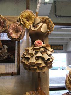 ESCAPARATE con vestido de periódico displays at Junk Bonanza