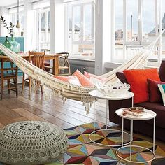 A large space of meeting with a rug and cushions by #BoConcept, a pouf by @zarahome and, of course... A HAMMOCK!