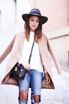 a classic camel coat and casual ripped jeans