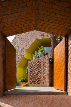 Kindergarten by Kientruc O looks like a cluster of brick houses