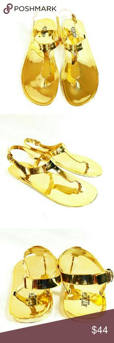 """Michael Kors MK Jelly Plate Gold Thong Sandals Thanks for checking out my closet. I take all my own pics. The shoes are authentic and new in box. Shoes have man made upper with 1/2"""" heel. MICHAEL Michael Kors Shoes Sandals"""