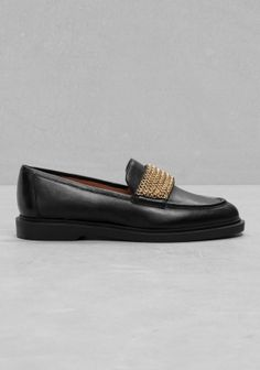 combining proper with quirky, these loafers are detailed with a chunky sole and a chain detail on the vamp.