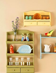 Paint vintage mid-century wooden spice racks to decorate plain walls