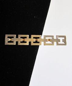 Vintage 1960s retro gold tone greek key hair clip. $9.50, via Etsy.