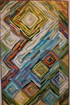 This unidentified quilt was pinned on a lot of boards at Pinterest, but I could not trace it to its source. Isn't it amazing?