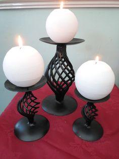 Set 3 candeleros hierro forjado. Incluye velas $1450.00