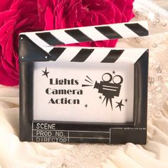 It�s lights camera action at your event with these movie themed place card and photo frames as your party or wedding favors.You can give your guests their chance to feel like they�re up on the silver screen when you display their names in these playful movie themed place card frames. Each poly resin frame is designed to resemble a classic movie clapboard ready to mark an exciting scene.Size: 3 �� x 3 �� ; Photo Window  $2.05