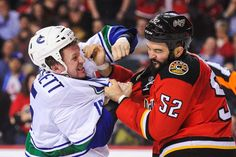 Punch-Out! - Brandon Bollig of the Calgary Flames fights Derek Dorsett of the Vancouver Canucks during an NHL game at Scotiabank Saddledome on April 7 in Calgary, Alberta, Canada. The Flames won - © Derek Leung/Getty Images Nhl Season, Nhl Games, Vancouver Canucks, Calgary, Hockey, Cool Photos, Captain Hat, Seasons, April 7