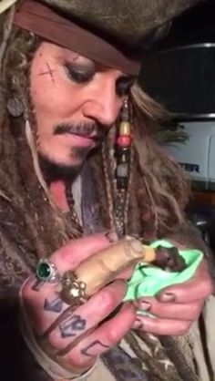 Johnny Depp bottle feeding his orphaned baby bat Excuse me while I go cry