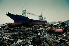 The aftermath of the earthquake and tsunami in Kesennuma, Tohoku, Japan. After being carried from the port, a freighter sits atop the wreckage of cars and houses, 4 miles inland. Remo Camerota @Smithsonian Magazine