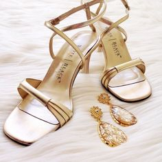 Gold metallic sandals WHBM gold strappy sandals with 3 inch heel, elegant metallic finish. Worn only once, too big for me. They have a couple of scuffs, one on front of right shoe (see cover photo) and very minor one on each heel (see last photo). White House Black Market Shoes Sandals
