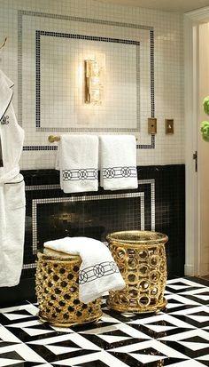 Black & white tile wall & floor in this amazing master bedroom - don't forget the gold accents and plush towels.