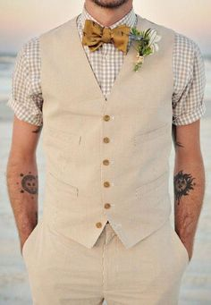 Groom style inspiration, vest and bowtie. I can't believe he likes this look