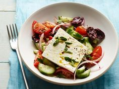 Classic Greek Salad : Make this restaurant favorite at home with cucumbers, tomatoes, olives, feta and an easy homemade Greek dressing.