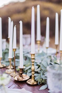 A collection of tapered candles in antique holders of different heights makes for a romantic tablescape | Marissa Kay Photography | Bridal Musings Wedding Blog
