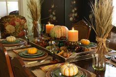 A Beautiful Autumn Spread     Fill a wooden tray with fall items and small pillar candles/w holders.  Finish with a hefty arrangement of wheat and grasses tied with raffia at each end.