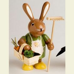 Easter decoration: Bunny female with rake - 11 cm / 4 inches