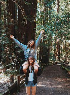 jean shorts jacket white shirt gray shirt purse camera park trail trees logs