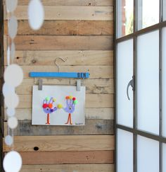Use pants hanger to display kids artwork