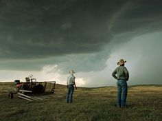 See a photo of farmers watching a thunderstorm in Nebraska, by Jim Richardson from National Geographic.