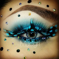 Stunning blue eye shadow and blue polka dot eye lashes with crystal accents galore!
