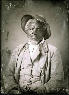 African American man, unidentified, grey hair and goatee, with rough looking hat, buckskin vest, and heavy corduroy jacket. | collections.mohistory.org