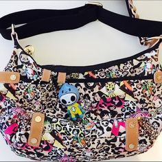 Tokidoki Leopard Nylon Crossbody Bag LVE this bag from Tokidoki by Simone Legno. I can vouch for its authenticity as I purchased this myself at Macy's department store in 2008. I've never used it and is in Mint condition. Has just been in storage. The details on this are amazing. Shiny gold tone hardware, tan leather accents, rainbow zipper, 2 ballchain key rings on front and a keychain hook inside. Black webbed adjustable strap. Please feel free to ask any other questions! ✌️ Tokidoki Bags…