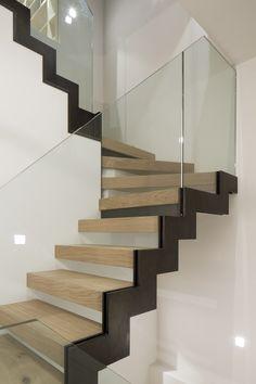 Zig zag stair, bronze stringer, oak treads, glass balustrade www.peekarchitecture.co.uk