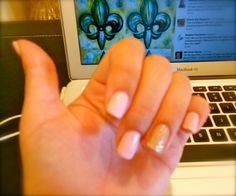 """Pale pink nails with a gold glitter """"bling nail."""" -- My favorite Schlack mani."""
