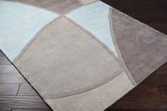 This area rug is great for a contemporary coastal space. Its combination of sky blue, light grey and taupe will work well within your beachy living room!
