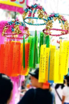 One popular Tanabata custom is to write ones wishes on a piece of paper, and hang that piece of paper on a specially erected bamboo tree, in the hope that the wishes become true
