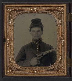 [Unidentified soldier in Union cavalry uniform with revolver] (LOC) by The Library of Congress, via Flickr