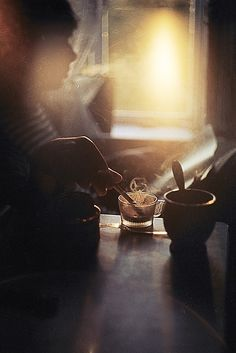 Beautiful shot - I love the mix of different color lights, the blue on the table and the sun coming from the window. Also, the smoke adds so much to the scene and then of course that lens flare! So gorgeous!!