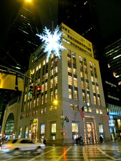 The UNICEF Snowflake, suspended over Fifth Avenue at 57th Street, has been a New York City Christmas tradition since 1984. The lighted crystal ornament -- shown in front of Tiffany and Co., 727 Fifth Avenue -- is 23 feet in diameter, 28 feet high, and approximately 3,300 pounds.