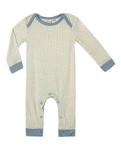This very cute romper is exclusively designed by Sapling, an Australian company specialising in 100% organic cotton children's wear.   Starburst. Little Boy Blue. Made from super soft, high quality, double jersey.  100% GOTS certified organic cotton.   Printed with 100% GOTS approved water based dyes that are free from toxic chemicals and heavy metals. Features an envelope neckline for easy dressing. Proudly made in India under fair trade terms and conditions.