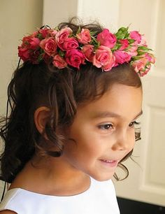 An adorable pink rose garland for the flower girl. Lani Elizabeth Fine Design in Flowers and Events.