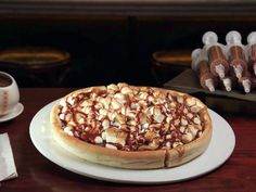 #5: Chocolate Chunk Pizza — Max Brenner : At Philadelphia's Max Brenner, chocolate is the menu. And there's one dish in particular that's worth trying: the Chocolate Chunk Pizza. It all starts with a deep-dish pizza crust that's sprinkled with chopped milk and white chocolates, marshmallows and peanut butter sauce. Tableside it's served with a syringe filled with chocolate ganache.
