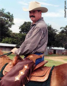gay cowboys riding horses chaps moustache CORNYCREEKLIVESTOCK.com