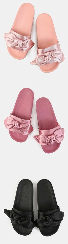 """Look perfectly put together even on your casual days with the Bow Tie Satin Slide Sandals! Features an open toe, satin-like upper, bow tie design and a classic slide silhouette. Finished with a 1"""" flat sole. Pair with high waist satin trousers."""