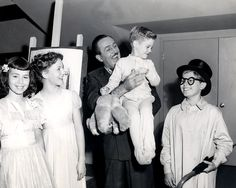 Walt Disney with the child voice actors of Peter Pan (1953).