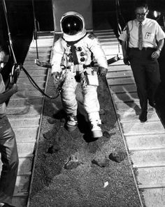 """On August 28, 1970 at Cape Canaveral, the Apollo 14 astronaut Ed Mitchell is attached to a """"six-degrees-of-freedom simulator,"""" training for his 1971 moonwalk. (NASA)"""