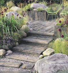Timberstone Sleepers and Setts, Driftwood, with Large specimen Boulders and Cobbles.