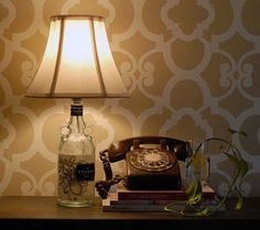 DIY Lighting Ideas and Cool DIY Light Projects for the Home. Chandeliers, lamps, awesome pendants and creative hanging fixtures,  complete with tutorials with instructions | Liquor Bottle DIY Lamp | http://diyjoy.com/diy-projects-lighting-ideas