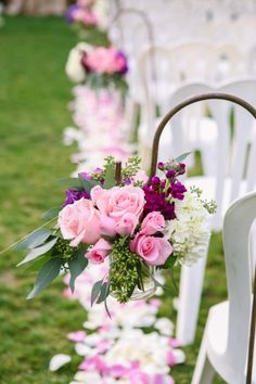 Pink roses and eucalyptus small wedding aisle flowers.