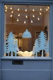 Resultado de imagen para ventanas decoradas de navidad con nieve