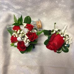 Traditional red spray rose corsage and a large red rose boutonniere with baby's breath and silver ribbon