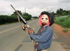 Liberia Civil War | aug 11 1990 a masked rebel loyal to warlord charles
