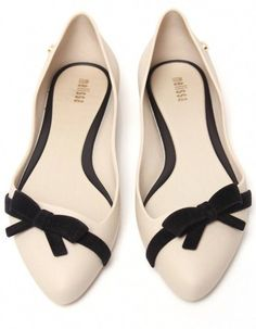 #Ivory flats wiith black bow accent detail